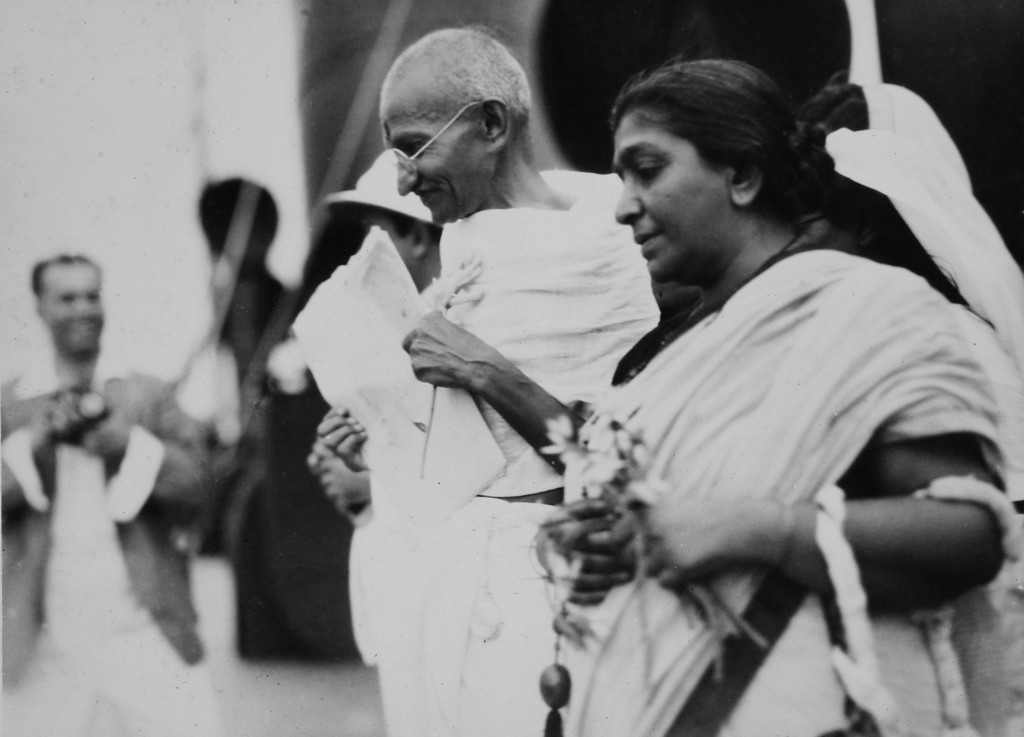 . Mahatma Gandhi and fellow delegate Sarojini Naidu en route to London for the Second Round Table Conference on Dominion Status for India. Photo from a period album collected by AP reporter James A. Mills, ca. 1931. (AP Photo/James A. Mills)