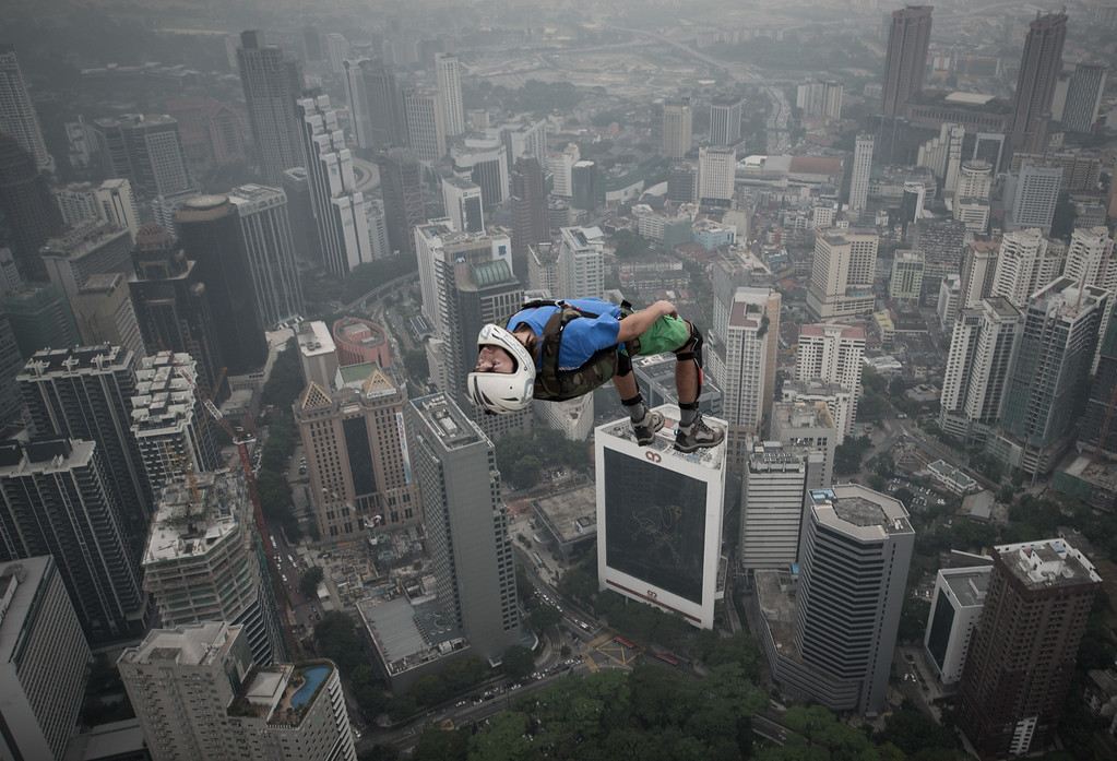 . Base jumper Denis Odintsov from Russian leaps from the 300-meters Open Deck of the Malaysia\'s landmark Kuala Lumpur Tower during the International Tower Jump in Kuala Lumpur on September 27, 2013. Some 103 professional base jumpers from 20 countries are taking part in the annual event. AFP PHOTO / MOHD RASFAN/AFP/Getty Images