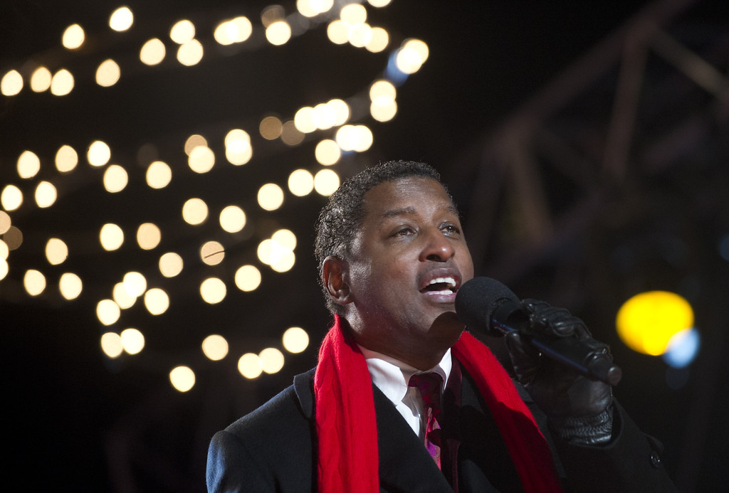 ". Singer Kenny ""Babyface\"" Edmonds performs during the National Christmas Tree Lighting on the Ellipse adjacent to the White House in Washington, DC, on December 6, 2012. The annual event, hosted by Actor Neil Patrick Harris, features US President Barack Obama and performances by Jason Mraz, Ledisi, James Taylor, Kenny \""Babyface\"" Edmonds, Colbie Caillat and American Idol season 11 winner Phillip Phillips.  SAUL LOEB/AFP/Getty Images"