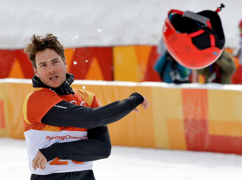 . Bronze medal winner Zan Kosir, of Slovenia, tosses his helmet after the men\'s parallel giant slalom small final at Phoenix Snow Park at the 2018 Winter Olympics in Pyeongchang, South Korea, Saturday, Feb. 24, 2018. (AP Photo/Kin Cheung)
