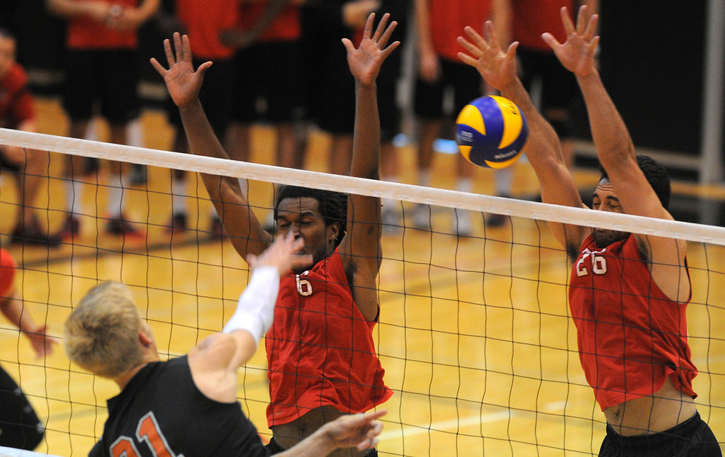 . LONG BEACH - 04/16/2013  (Photo: Scott Varley, Los Angeles Newspaper Group)  Long Beach City College defeated Orange Coast College to advance to the semifinal in the state mens volleyball playoffs. LBCC\'s Greg Utupo, right, blocks a shot by Johannes Brink as Eron Liddie is also at the net for the block.