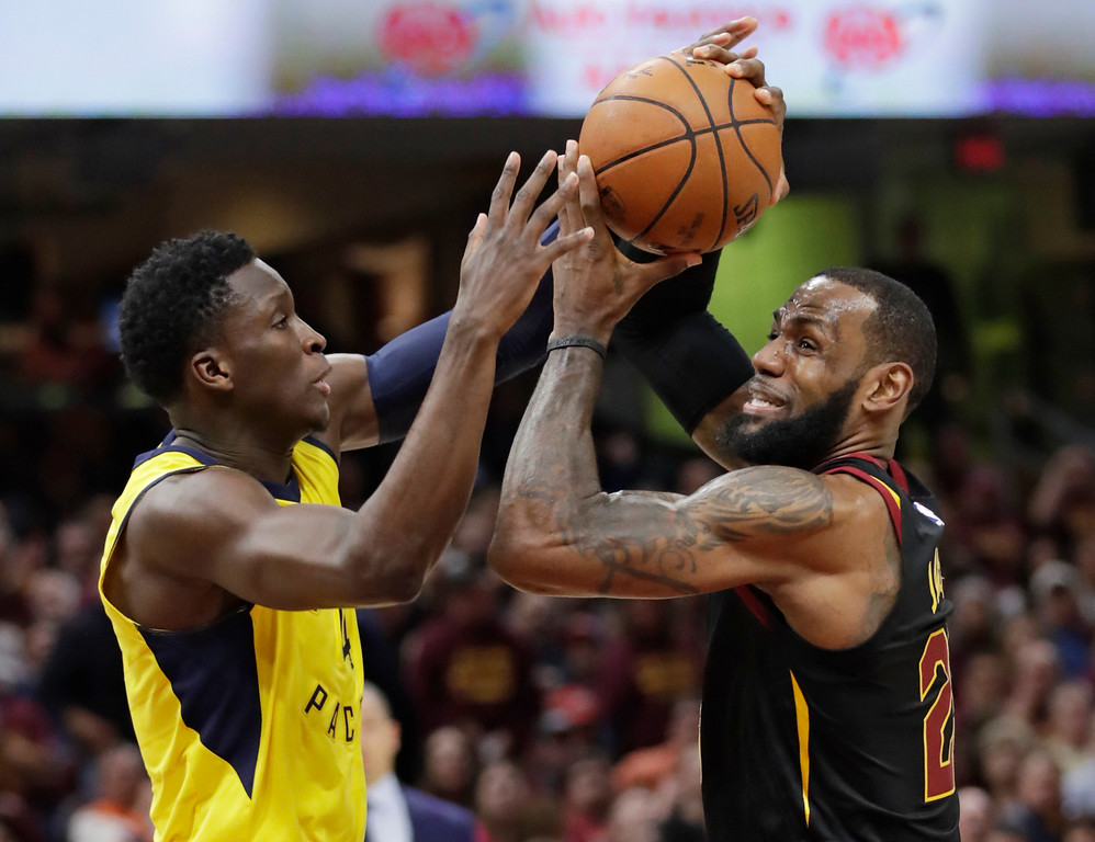 . Cleveland Cavaliers\' LeBron James, right, drives past Indiana Pacers\' Victor Oladipo in the first half of Game 5 of an NBA basketball first-round playoff series, Wednesday, April 25, 2018, in Cleveland. (AP Photo/Tony Dejak)