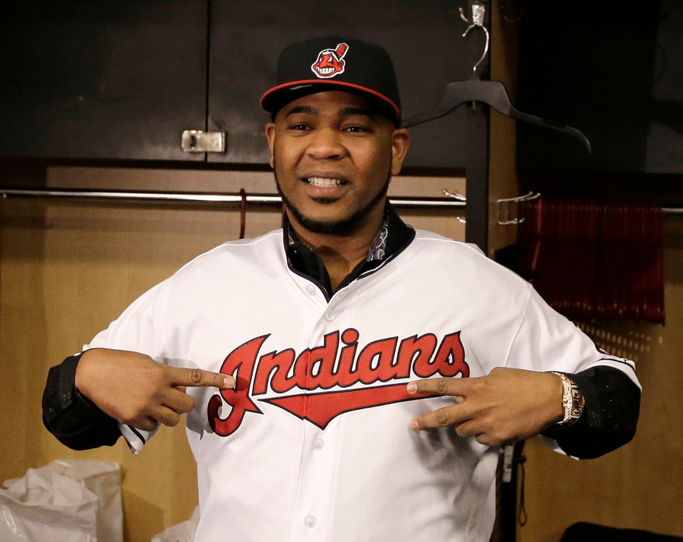 . Cleveland Indians\' Edwin Encarnacion smiles wearing a Cleveland Indians jersey, Thursday, Jan. 5, 2017, in Cleveland. One win from a World Series baseball title last season, the Indians finalized a $65 million, three-year contract with free agent slugger Encarnacion. (AP Photo/Tony Dejak)
