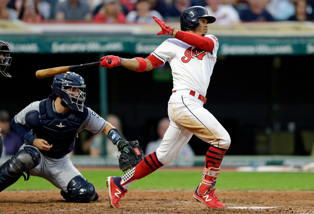 . Cleveland Indians\' Francisco Lindor hits a one-run double off San Diego Padres starting pitcher Luis Perdomo in the fifth inning of a baseball game, Wednesday, July 5, 2017, in Cleveland. Erik Gonzalez scored on the play. Catcher Luis Torrens watches.(AP Photo/Tony Dejak)