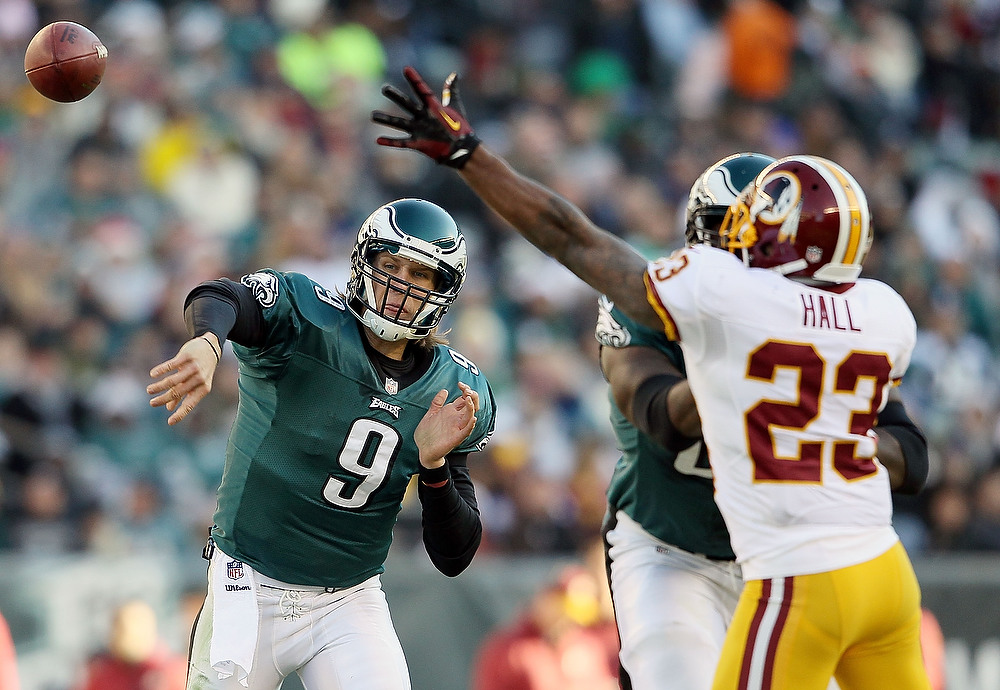 . Nick Foles #9 of the Philadelphia Eagles makes a pass against the Washington Redskins at Lincoln Financial Field on December 23, 2012 in Philadelphia, Pennsylvania.  (Photo by Alex Trautwig/Getty Images)