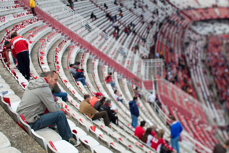 Sevilla FC fans taking their seats before the Spanish Liga football game between Sevilla FC and Real Madrid CF that took place at Sanchez Pizjuan stadium, Seville, Spain, on 26 April 2009. Tilted lens used for shallower depth of field.