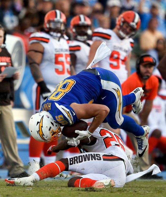 . Los Angeles Chargers tight end Hunter Henry is tackled by Cleveland Browns strong safety Derrick Kindred during the second half of an NFL football game Sunday, Dec. 3, 2017, in Carson, Calif. (AP Photo/Kelvin Kuo)