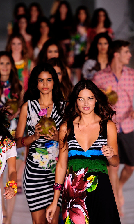 . Brazilian model Adriana Lima, right, and other models wear creations from Desigual during a 080 Barcelona fashion show in Barcelona, Spain, Tuesday, July 9, 2013.  (AP Photo/Manu Fernandez)