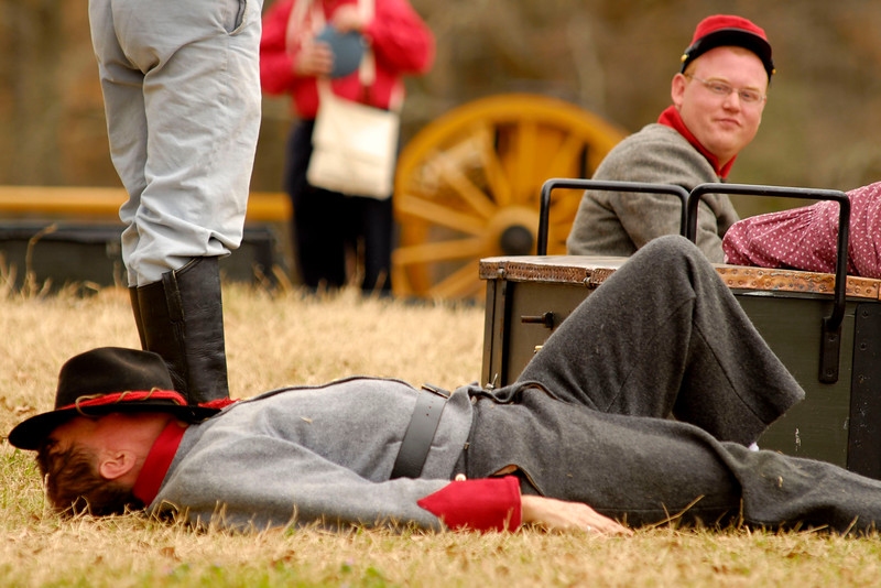 An artillery reenactor takes a nap on the battlefield before the reenactment. The Skirmish at Gamble's Hotel happened on March 5, 1885 when 500 federal soldiers, under the command of Reuben Williams of the 12th Indiana Infantry, marched into Florence to destroy the railroad depot but were met by Confederate soldiers backed up with 400 militia. The reenactment, held by the 23rd South Carolina Infantry, was held at the Rankin Plantation in Florence, South Carolina on Saturday, March 5, 2011. Photo Copyright 2011 Jason Barnette