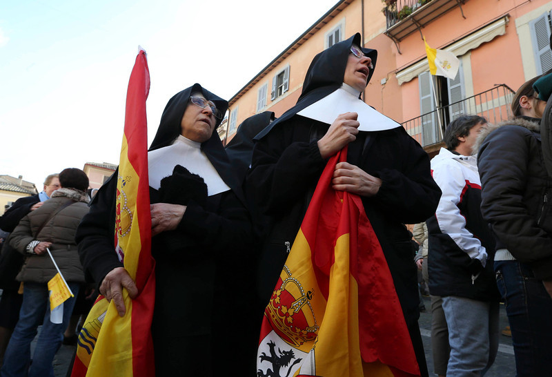 . Two nuns stand in front of Pope\'s summer residence of Castel Gandolfo, the scenic town where Pope Benedict XVI will spend his first post-Vatican days and make his last public blessing as pope,Thursday, Feb. 28, 2013. (AP Photo/Luca Bruno)