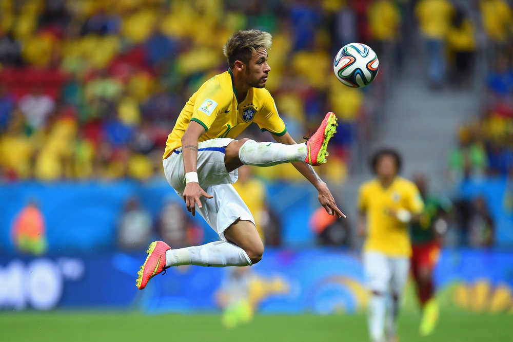 . Neymar of Brazil controls the ball during the 2014 FIFA World Cup Brazil Group A match between Cameroon and Brazil at Estadio Nacional on June 23, 2014 in Brasilia, Brazil.  (Photo by Stu Forster/Getty Images)