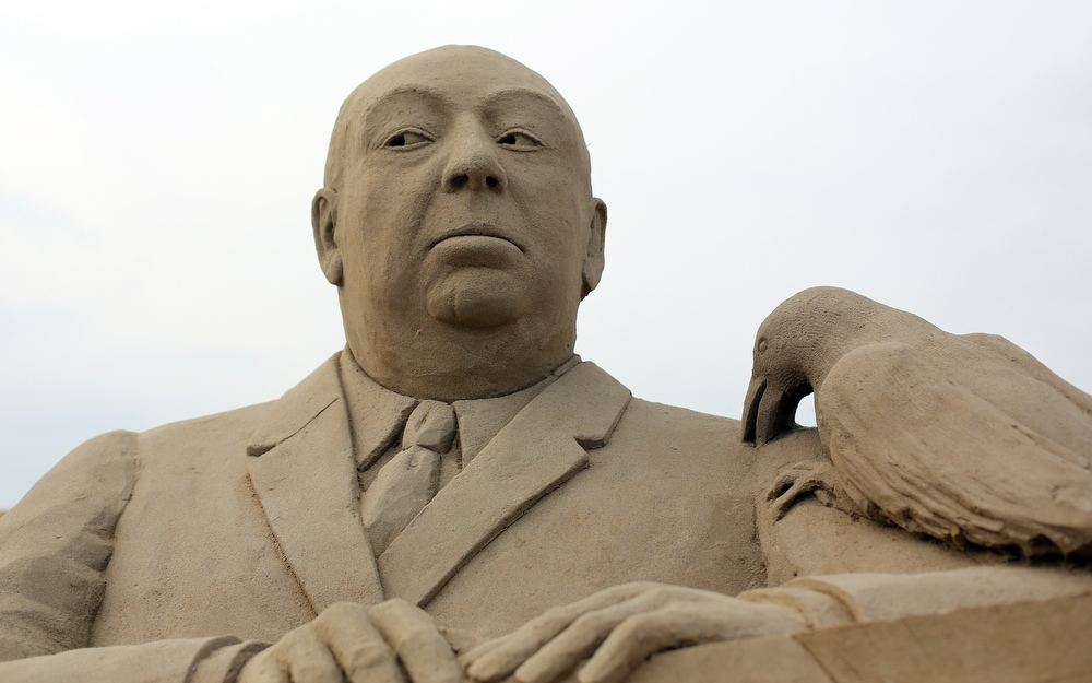 Description of . Detail of a sand sculpture of Alfred Hitchcock is seen as pieces are prepared as part of this year's Hollywood themed annual Weston-super-Mare Sand Sculpture festival on March 26, 2013 in Weston-Super-Mare, England. Due to open on Good Friday, currently twenty award winning sand sculptors from across the globe are working to create sand sculptures including Harry Potter, Marilyn Monroe and characters from the Star Wars films as part of the town's very own movie themed festival on the beach.  (Photo by Matt Cardy/Getty Images)