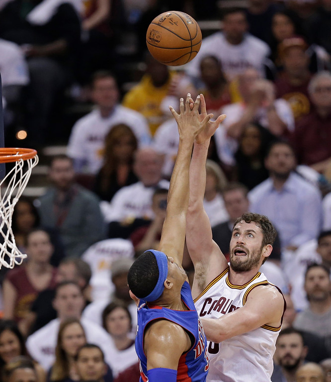 . Cleveland Cavaliers\' Kevin Love, right, shoots over Detroit Pistons\' Tobias Harris (34) in the first half in Game 2 of a first-round NBA basketball playoff series, Wednesday, April 20, 2016, in Cleveland. (AP Photo/Tony Dejak)