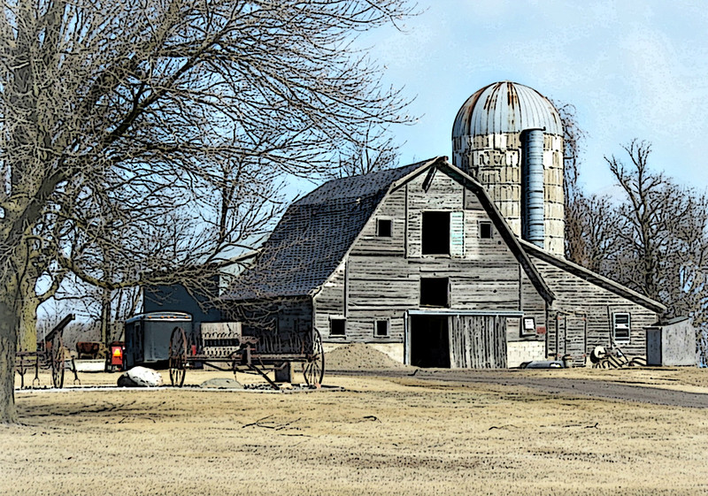 Grey Barn with Old Farm Machinery