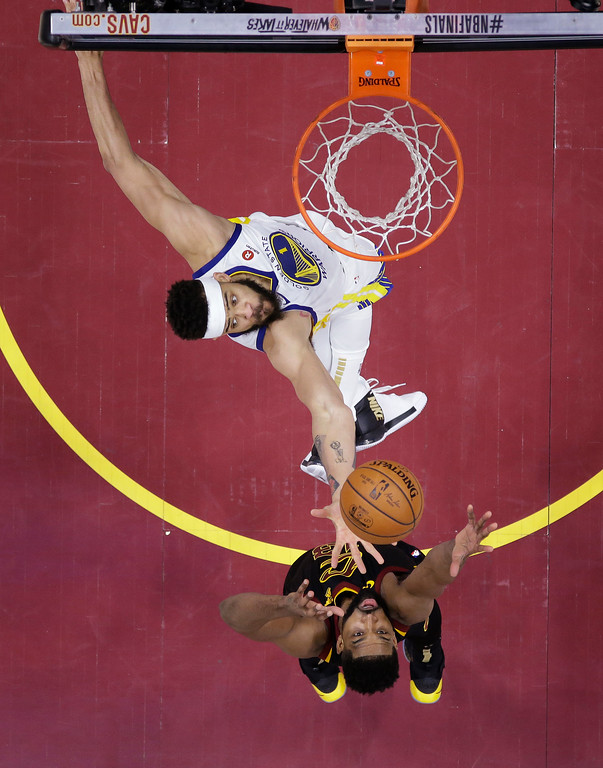 . Cleveland Cavaliers\' Larry Nance Jr. and Golden State Warriors\' JaVale McGee go for a rebound during the second half of Game 4 of basketball\'s NBA Finals, Friday, June 8, 2018, in Cleveland. (AP Photo/Carlos Osorio, Pool)