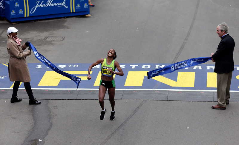 . Caroline Rotich, of Kenya, wins the women\'s division of the Boston Marathon, Monday, April 20, 2015, in Boston. (AP Photo/Charles Krupa)