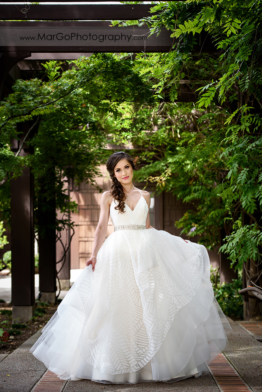 full body portrait of bride in beautiful dresses at Saratoga Foothill Club