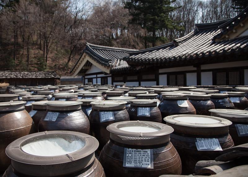 Gochujang and doenjang fermenting in the sun.