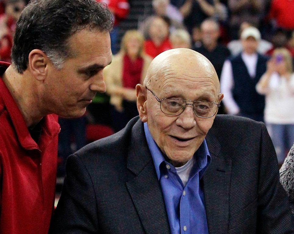 . In this March 1, 2014, file photo, Jerry Tarkanian is escorted by his son, Danny, during halftime ceremonies honoring the former Fresno State coach, in Fresno, Calif. (AP Photo/Gary Kazanjian, File)