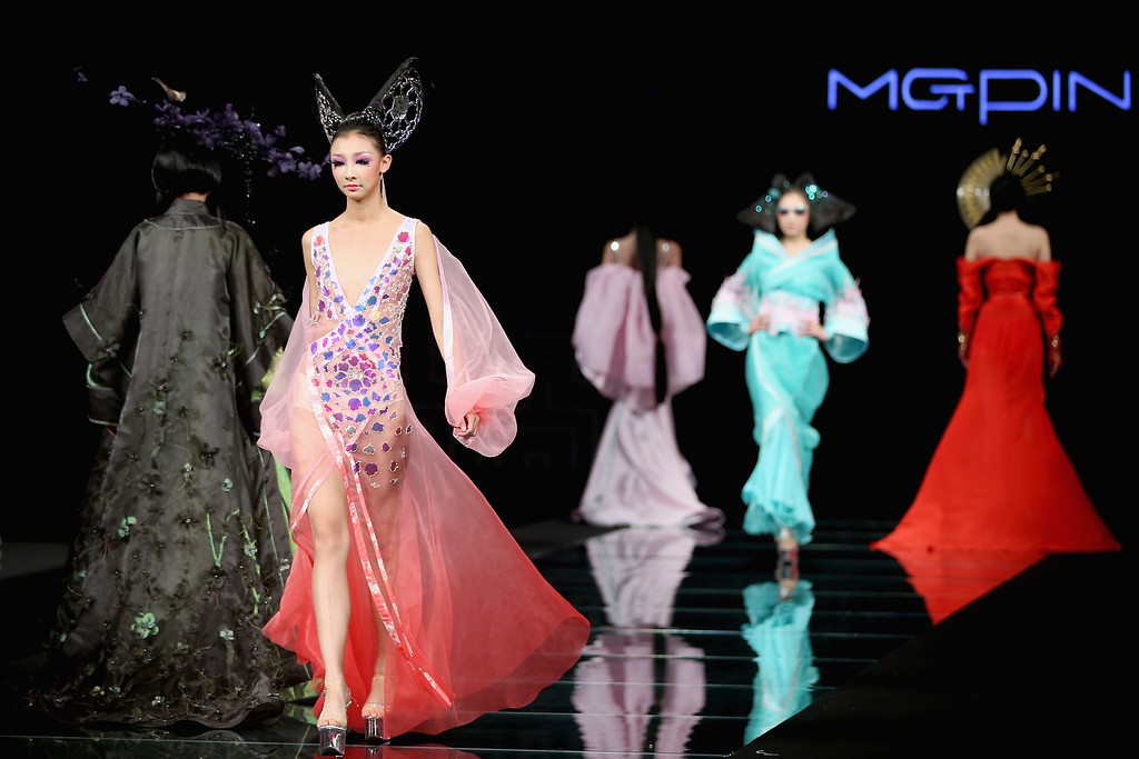 . Models showcase designs on the runway at MGPIN 2015 Mao Geping Makeup Trends Launch show during Mercedes-Benz China Fashion Week Spring/Summer 2015 at Beijing Hotel on October 27, 2014 in Beijing, China.  (Photo by Feng Li/Getty Images)