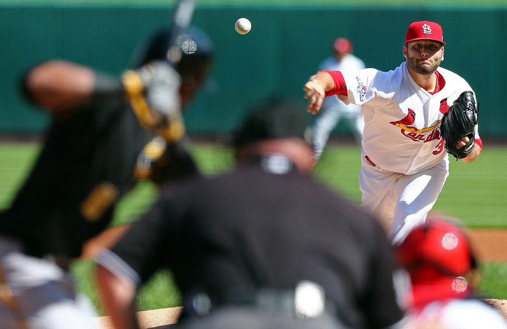 . St. Louis Cardinals pitcher Lance Lynn pitches against Pittsburgh Pirates\' Starling Marte in the first inning of Game 2 of baseball\'s National League division series on Thursday, Oct. 3, 2013, in St. Louis. (AP Photo/Elsa, Pool)