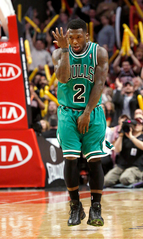 . Chicago Bulls guard Nate Robinson reacts after hitting a 3-pointer late in overtime of an NBA basketball game against the Denver Nuggets, Monday, March 18, 2013, in Chicago. The Nuggets won 119-118. (AP Photo/Charles Rex Arbogast)