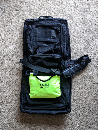 The outside pockets are on both sides of the bag and the larger ones can fit the rain cover if you do not want it dangling on the outside.