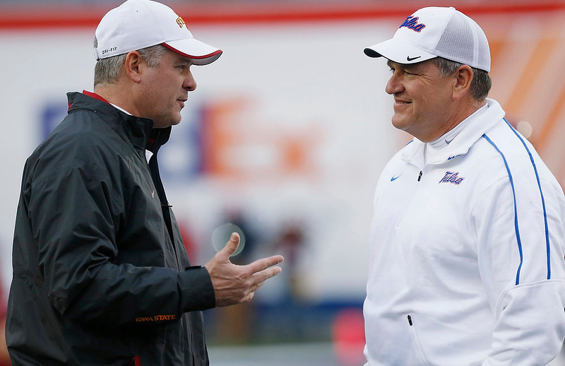. Iowa State coach Paul Rhoads, left, and Tulsa coach Bill Blankenship exchange greetings before the Liberty Bowl NCAA college football game in Memphis, Tenn., Monday, Dec. 31, 2012.  (AP Photo/Rogelio V. Solis)