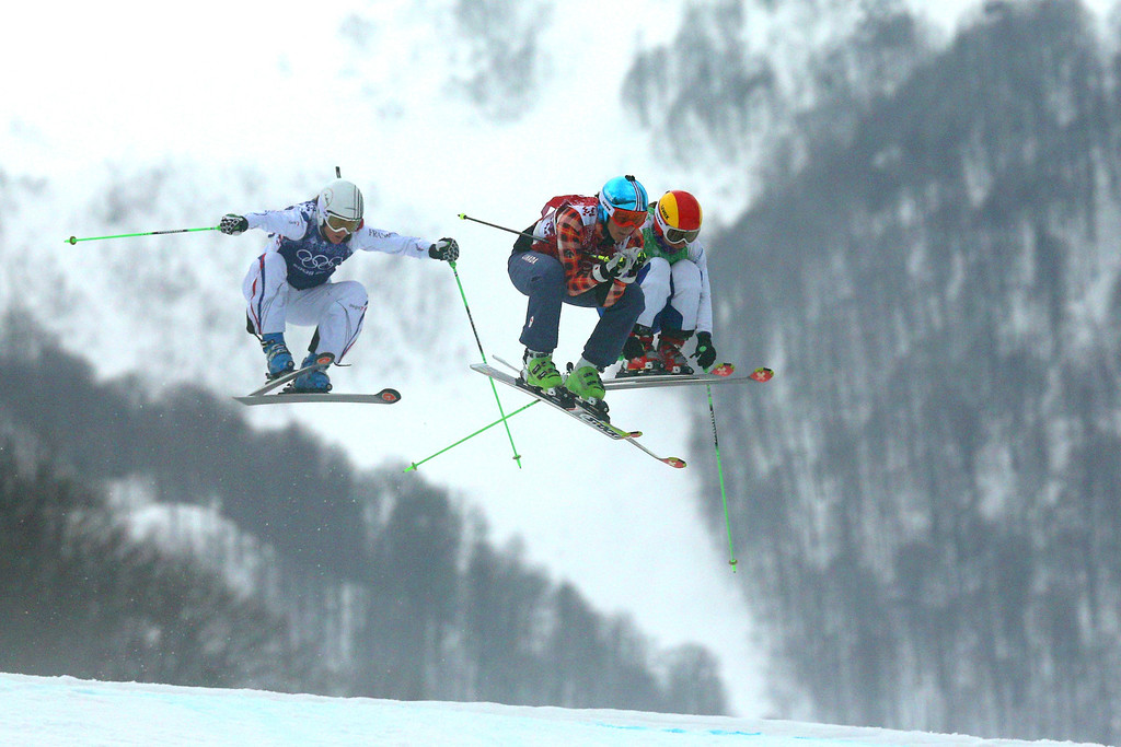 . (L-R) Alizee Baron of France, Marielle Thompson of Canada, Yulia Livinskaya of Russia compete in the Freestyle Skiing Womens\' Ski Cross 1/8 Finals on day 14 of the 2014 Winter Olympics at Rosa Khutor Extreme Park on February 21, 2014 in Sochi, Russia.  (Photo by Cameron Spencer/Getty Images)