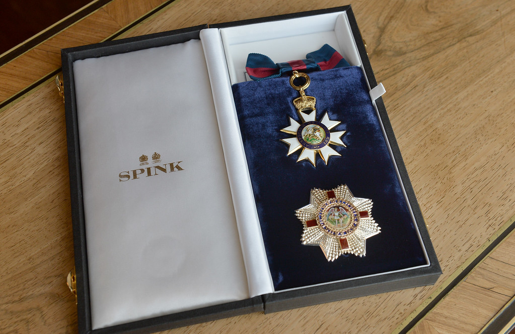 . Detail of the Insignia of the Honorary Dame Grand Cross of the Most Distinguished Order of St Michael and St George presented to Angelina Jolie by Queen Elizabeth II in the 1844 Room on October 10, 2014 at Buckingham Palace, London.  (Photo by Anthony Devlin - WPA Pool/Getty Images)