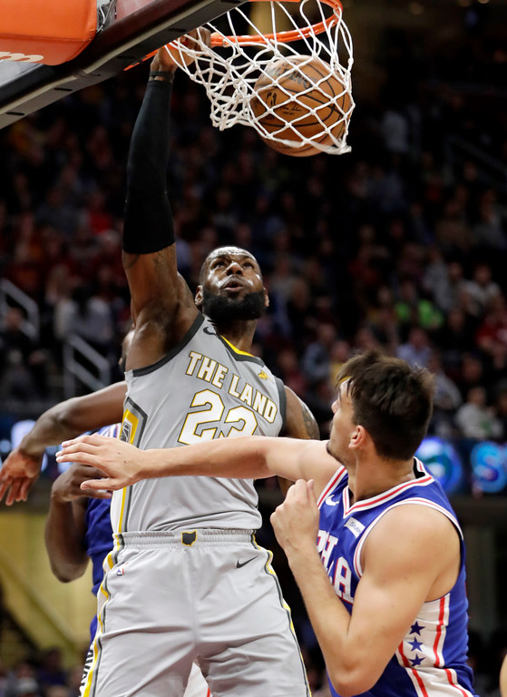 . Cleveland Cavaliers\' LeBron James (23) dunks against Philadelphia 76ers\' Dario Saric, from Croatia, in the first half of an NBA basketball game, Thursday, March 1, 2018, in Cleveland. (AP Photo/Tony Dejak)