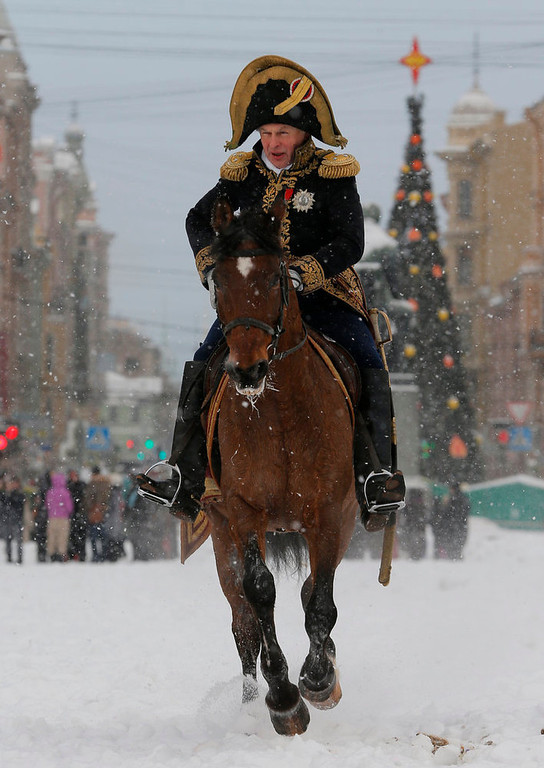 . A member of historic club wearing 1812-era French army general\'s uniform rides during a reenactment of the French Invasion of Russia in 1812, during celebrations to mark the Russian Orthodox Christmas in  St. Peterburg, Russia, Monday, Jan. 7, 2013.  Christmas falls on Jan. 7 for Orthodox Christians who rely on the old Julian calendar rather than the  Gregorian calendar adopted by Catholics and Protestants and commonly used in secular life around the world. (AP Photo/Dmitry Lovetsky)