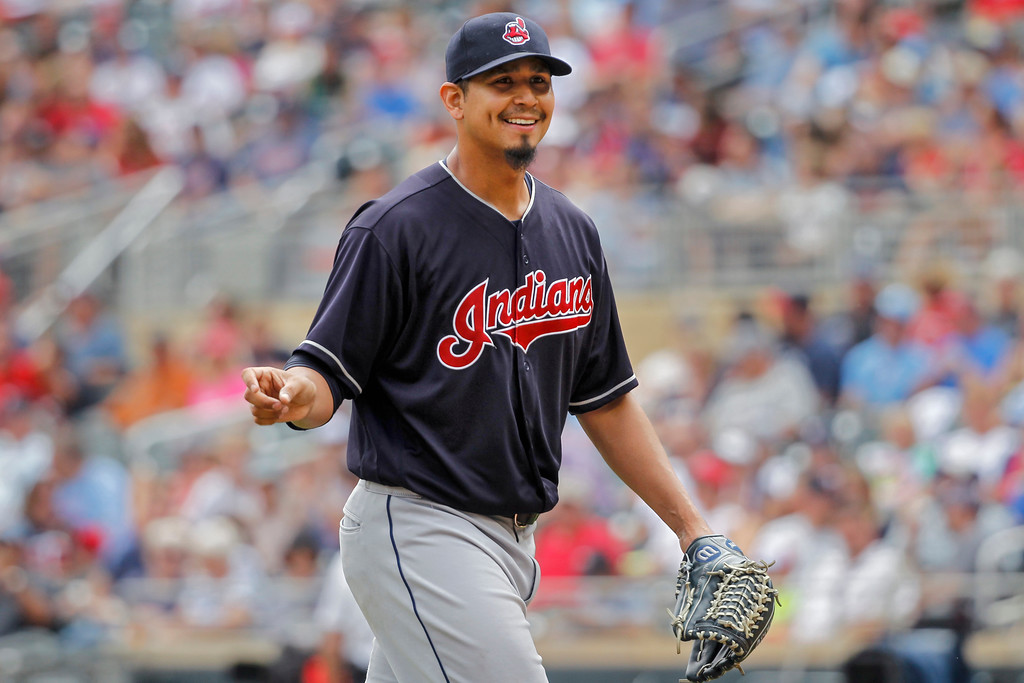 . Cleveland Indians starting pitcher Carlos Carrasco (59) smiles as he leaves the field with a lead over the Minnesota Twins in the eighth inning of a baseball game Wednesday, Aug. 1, 2018, in Minneapolis. The Indians won 2-0 with Carrasco earning the victory. (AP Photo/Bruce Kluckhohn)