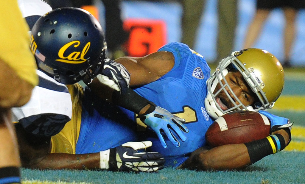 . UCLA wide receiver Shaquelle Evans (1) reacts in the end-zone after catching a pass for a 22 yard touchdown over California defensive back Isaac Lapite (20) during the second half of their college football game in the Rose Bowl in Pasadena, Calif., on Saturday, Oct. 12, 2013.   (Keith Birmingham Pasadena Star-News)