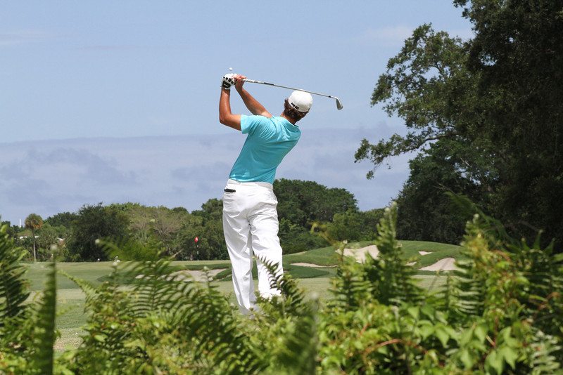 A competitor watches his tee shot sail into the light blue sky during the second round of the 95th Western Junior championship.