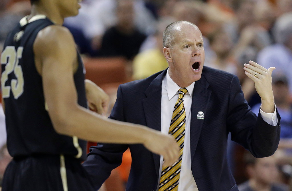 . Colorado coach Tad Boyle signals to his players during the first half of a second-round game of the NCAA college basketball tournament against Illinois, Friday, March 22, 2013, in Austin, Texas.  (AP Photo/Eric Gay)