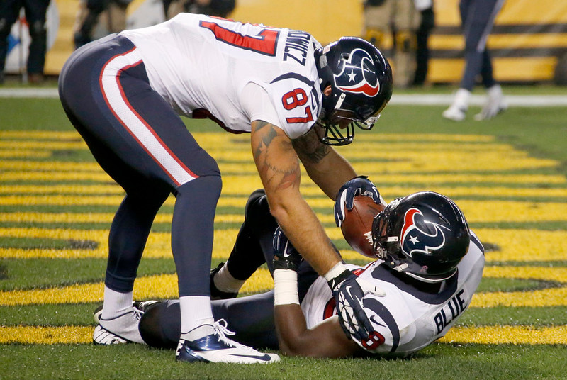 . Houston Texans running back Alfred Blue (28) is greeted by tight end C.J. Fiedorowicz (87) after scoring a touchdown in the first quarter of the NFL football game against the Pittsburgh Steelers, Monday, Oct. 20, 2014 in Pittsburgh. (AP Photo/Gene Puskar)