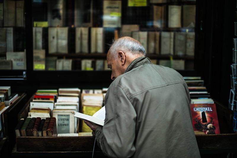 older man reading street bookstore.jpg