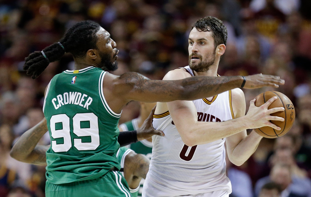 . Boston Celtics\' Jae Crowder (99) defends against Cleveland Cavaliers\' Kevin Love (0) during the first half of Game 4 of the NBA basketball Eastern Conference finals, Tuesday, May 23, 2017, in Cleveland. (AP Photo/Tony Dejak)
