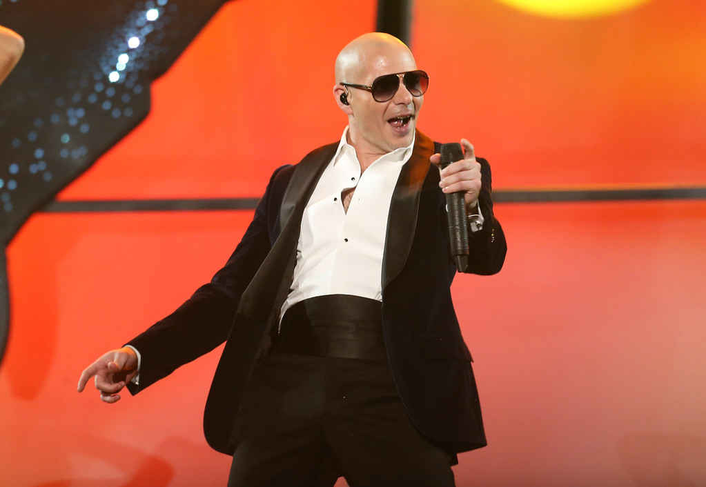 . Pitbull performs at the 42nd annual American Music Awards at Nokia Theatre L.A. Live on Sunday, Nov. 23, 2014, in Los Angeles. (Photo by Matt Sayles/Invision/AP)