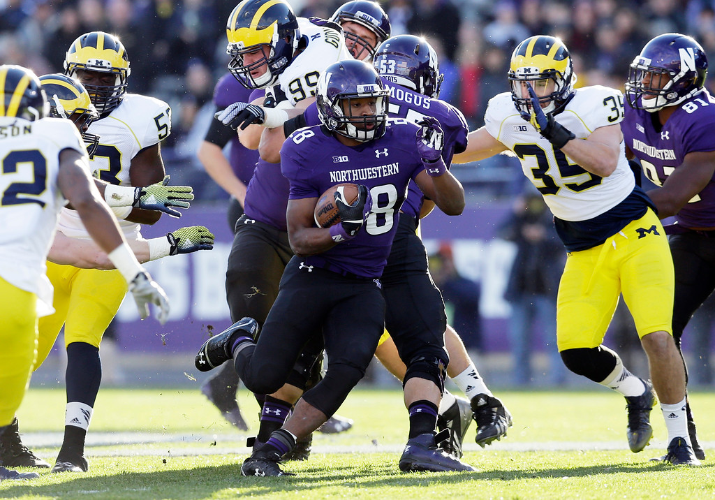 . Northwestern running back Justin Jackson (28) runs with the ball during the first half of an NCAA college football game against Michigan in Evanston, Ill., Saturday, Nov. 8, 2014. (AP Photo/Nam Y. Huh)