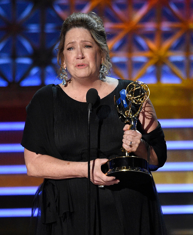 ". Ann Dowd accepts the award for outstanding supporting actress in a drama series for ""The Handmaid\'s Tale\"" at the 69th Primetime Emmy Awards on Sunday, Sept. 17, 2017, at the Microsoft Theater in Los Angeles. (Photo by Chris Pizzello/Invision/AP)"