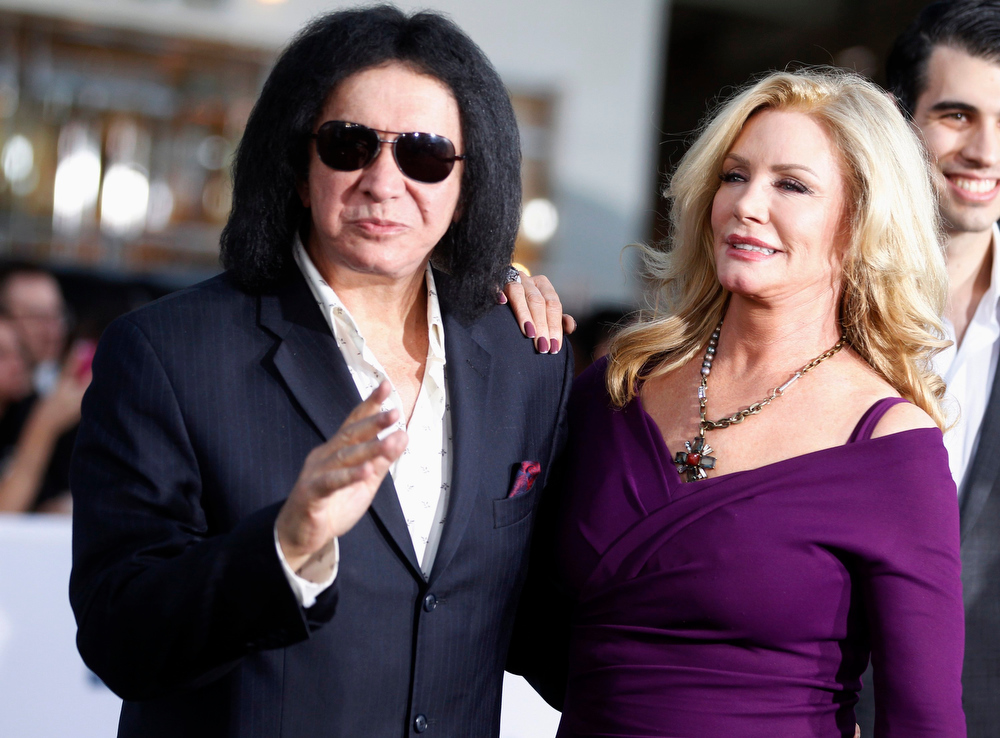 """. Musician Gene Simmons and wife Shannon Tweed arrive as guests at the premiere of the new film \""""Oblivion\"""" in Hollywood, California April 10, 2013. REUTERS/Fred Prouser"""