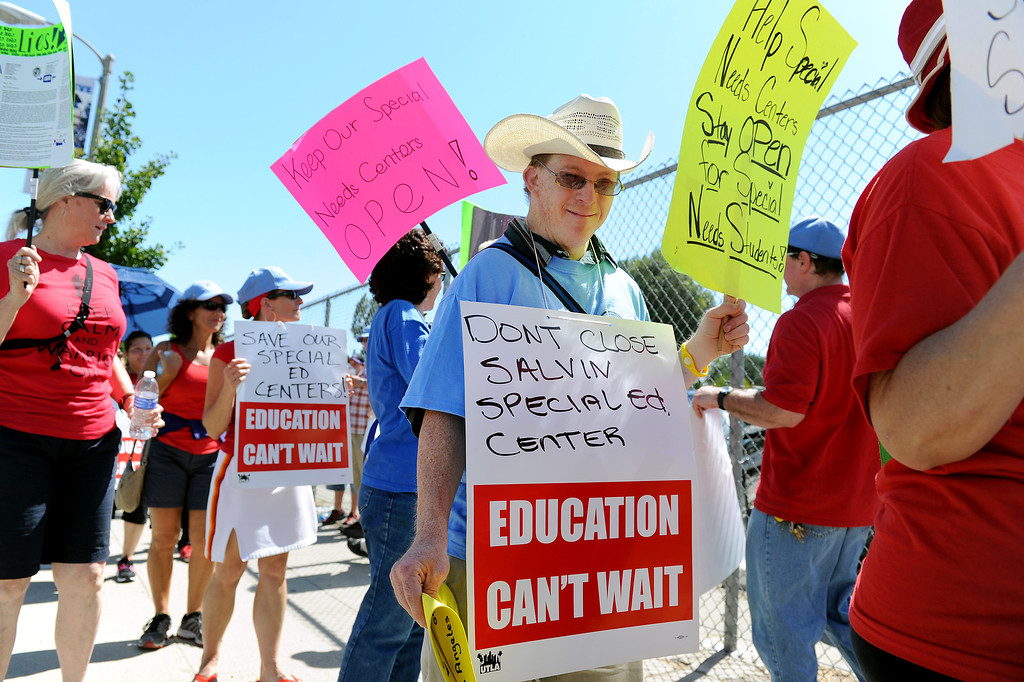 . People protest the closure of special education centers in front of the office of LAUSD board member Tamar Galatzan in Lake Balboa, Wednesday, July 24, 2013. Parents and Teachers United for Action picketed to voice their opposition to the district�s transitioning of special education students onto regular education campuses. (Michael Owen Baker/L.A. Daily News)