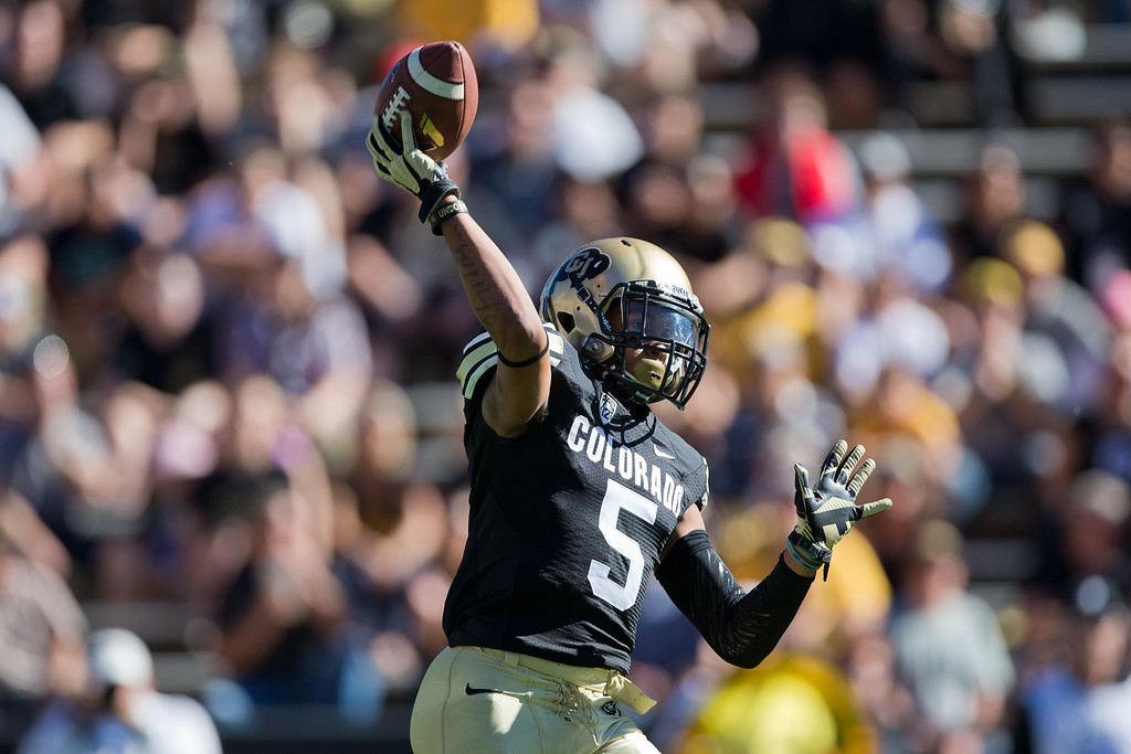 . BOULDER, CO - OCTOBER 25:  Wide receiver Shay Fields #5 of the Colorado Buffaloes throws a pass on a reverse during the first quarter against the UCLA Bruins at Folsom Field on October 25, 2014 in Boulder, Colorado. (Photo by Justin Edmonds/Getty Images)