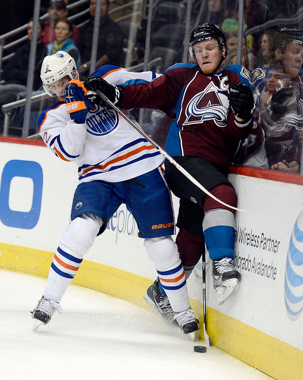 . DENVER, CO. - MARCH 12: Jeff Petry (2) of the Edmonton Oilers slams Gabriel Landeskog (92) of the Colorado Avalanche up against the boards during the third period March 12, 2013 at Pepsi Center. (Photo By John Leyba/The Denver Post)