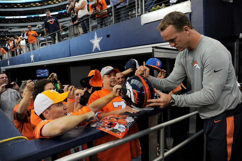 . ARLINGTON, TX - AUGUST 28: Denver Broncos quarterback Peyton Manning signs autographs before their game agains the Dallas Cowboys August 28, 2014 at AT&T Stadium. (Photo by John Leyba/The Denver Post)