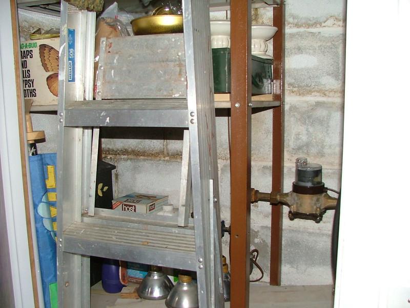 narrow closet with water meter?