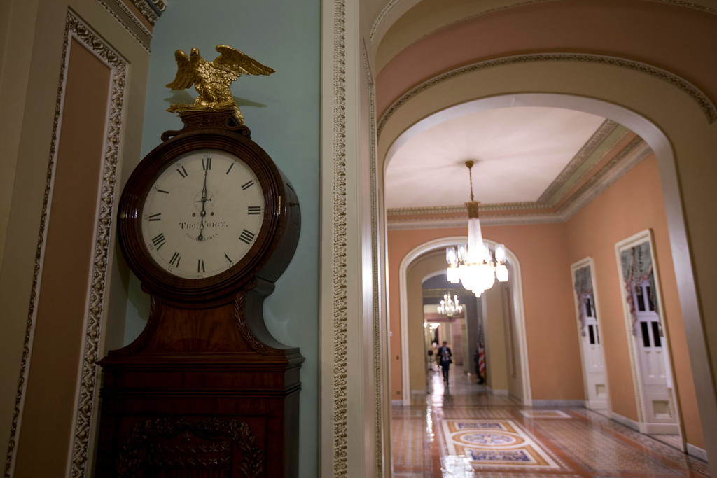 . The Ohio Clock strikes midnight as the Senate continues to work on the fiscal cliff, on Capitol Hill Tuesday, Jan. 1, 2013 in Washington. (AP Photo/Alex Brandon)