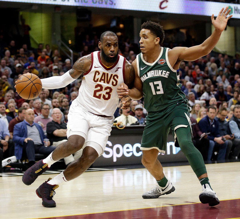 . Cleveland Cavaliers\' LeBron James (23) drives against Milwaukee Bucks\' Malcolm Brogdon (13) in the first half of an NBA basketball game, Tuesday, Nov. 7, 2017, in Cleveland. (AP Photo/Tony Dejak)